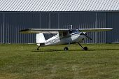 picture of cessna  - 1946 Cessna 120 parked in front of the hangar - JPG