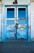 stock photo of anza  - Blue doors of the Casa Juan de Anza built in 1799 in San Juan Bautista California - JPG