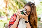Close Up Of Young Asian Woman Snap Her Camera Outdoor And Enjoyed Her City Lifestyle On Weekend. You poster