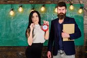 Man With Beard Hold Book And Sexy Girl Teacher Holds Alarm Clock, Chalkboard On Background. Lady Tea poster