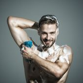 Relax And Hygiene, Spa And Beauty, Healthcare - Handsome Man Washing With Sponge In Shower. He Is Sm poster