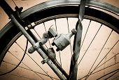 stock photo of dynamo  - old bike and  dynamo in retro color - JPG