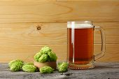 Glass Beer On Light Wooden Background. Beer Brewery Concept. Beer Background poster