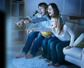 picture of home theater  - Family watching TV  - JPG