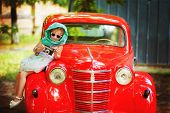 Little 2 Years Old Girl In Retro Style With Old Fashioned Camera In Hands, White Dress, Sunglasses A poster