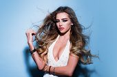 Beauty Woman. Cosmetology. Girl With Long And Shiny Wavy Hair. Beautiful Girl. Beautiful Elegant Wom poster