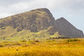 Easter Island Landscape With The Slopes Of The Volcano Rano Raraku In The Background, Easter Island. poster