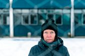 Worried Concerned Serious Woman Behind Chain-link Fence As Obstacle On Cold Winter Day poster