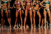Group Young Women In Bright Bikinis Competitive Fitness Bikini poster