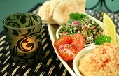 picture of tabouleh  - Tabouleh with hommus and lemon chick peas with fresh pita bread with candle. ** Note: Shallow depth of field - JPG