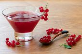 Glass Bowl Of Red Current Jam With Wooden Spoon Full Of Many Ripe Juicy Red Current Berries On Dark  poster