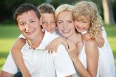 picture of happy family  - Family in summer park - JPG