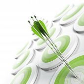 stock photo of competition  - many green targets and three arrows reaching the center of objective image fading from green to white with blur effect square format - JPG