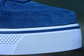 Part Of The Shoe Made Of Blue Suede And White Plastic Sole poster