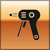 Black Electric Hot Glue Gun Icon Isolated On Gold Background. Hot Pistol Glue. Hot Repair Work Appli poster