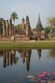 View Of The Ruins Of The Ancient Buddhist Temple Wat Chana Songkram On A Cloudy Day. Sukhothai, Thai poster