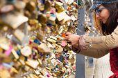 Woman Locking Love Padlock On Bridge. Woman In Love .people Lifestyle. Beautiful People In Love. Lif poster