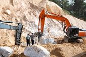 An Excavator Loader Machine And Stone Jacking Machine During Earthmoving Works At Construction Site  poster