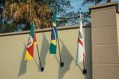 Wall With Flags From Brazil, Rio Grande Do Sul State And Municipality Of Bento Goncalves. A Friendly poster