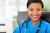 stock photo of nurse uniform  - beautiful female african american medical nurse with stethoscope - JPG