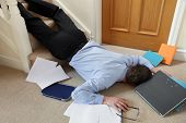 stock photo of injury  - Business man falling down the stairs in the office concept for accident and insurance injury claim at work - JPG