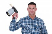Man showing blowtorch on white background poster