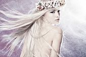 stock photo of goddess  - beautiful young woman with long blond flying hair and wreath of flowers - JPG
