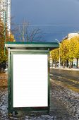 stock photo of bus-shelter  - A high dynamic range image of a bus stop with a blank bilboard for your advertising - JPG