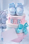 stock photo of christening  - Little baby booties and gift boxes with blank note - JPG