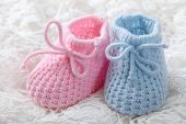 stock photo of booty  - Blue and pink baby booties on white background - JPG