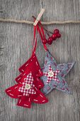 pic of clotheslines  - Christmas decoration over wooden background - JPG