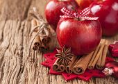 stock photo of cinnamon sticks  - Red winter apples with cinnamon sticks and anise - JPG