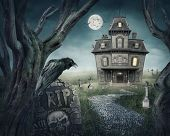 stock photo of creepy  - Haunted house and spooky graveyard - JPG