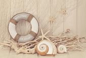 stock photo of fishnet  - Life buoy decoration on white shabby background - JPG
