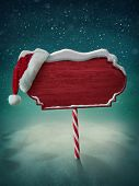 pic of snow forest  - Wooden red sign and santa hat - JPG
