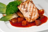 stock photo of mahi  - Plate of Mahi Mahi severd with vegetables pineapple and soy sauce - JPG