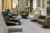 stock photo of showrooms  - Showroom of modern furniture store with luxury leather armchairs - JPG