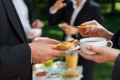 stock photo of buffet lunch  - Coffee and lunch break in the office garden - JPG