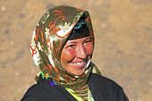 image of nomads  - Young nomad woman in the desert - JPG