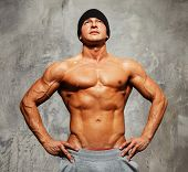 foto of beanie hat  - Handsome man with muscular torso in beanie hat posing - JPG