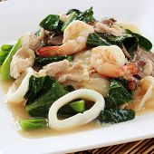 picture of thai cuisine  - Fried noodle with pork squid and shrimp soaked in gravy Chinese food  - JPG