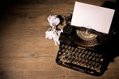 stock photo of fiction  - Vintage typewriter and a blank sheet of paper - JPG