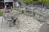 stock photo of minangkabau  - The stone chairs of Ambarita where tribal elders held council - JPG