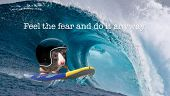 Feel the fear and do it anyway. A surfing rat with a crash helmet on a big wave. Motivational and co