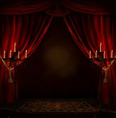 foto of illuminating  - view of a mystery room with red curtains and candles illuminating it - JPG
