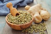 image of coffee crop  - Green coffee beans in wooden bowl with ginger - JPG