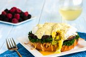 foto of benediction  - Vegetarian eggs benedict made with gouda cheese steamed kale sauteed portobello mushroom - JPG