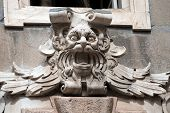 picture of genova  - Ancient grotesque stone mask on the facade of the building Tursi  - JPG