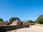 stock photo of outhouses  - Ancient agricultural outhouses made of dry stones in The Bories Village  - JPG