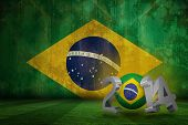 pic of football pitch  - Brazil 2014 against brazil flag in grunge effect - JPG